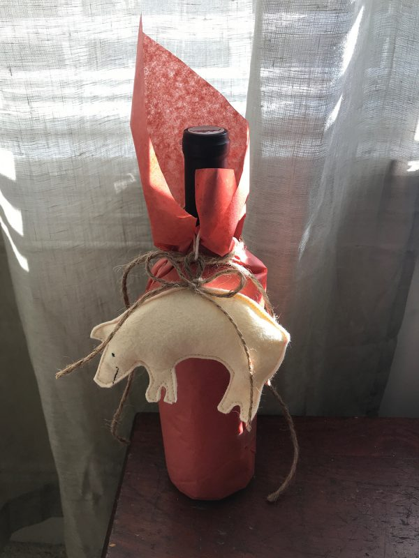 Pig Ornament tied to wine bottle
